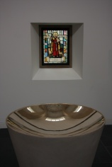 Reflection - Baptised Christians seek to reflect the life of Christ - like the saints depicted in stained glass windows.