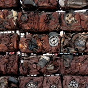 crushed cars create a wall - a new life and purpose, saying much about Christian faith